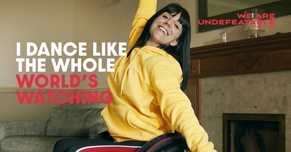 Image of a lady in a wheelchair, with the caption I dance like the whole world is watching