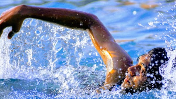 Person swimming front crawl